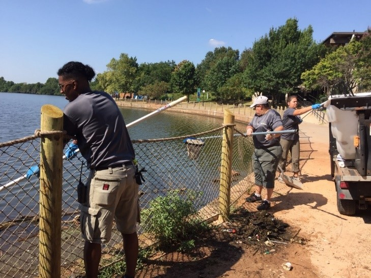 Zoo crew cleaning Zoo Lake
