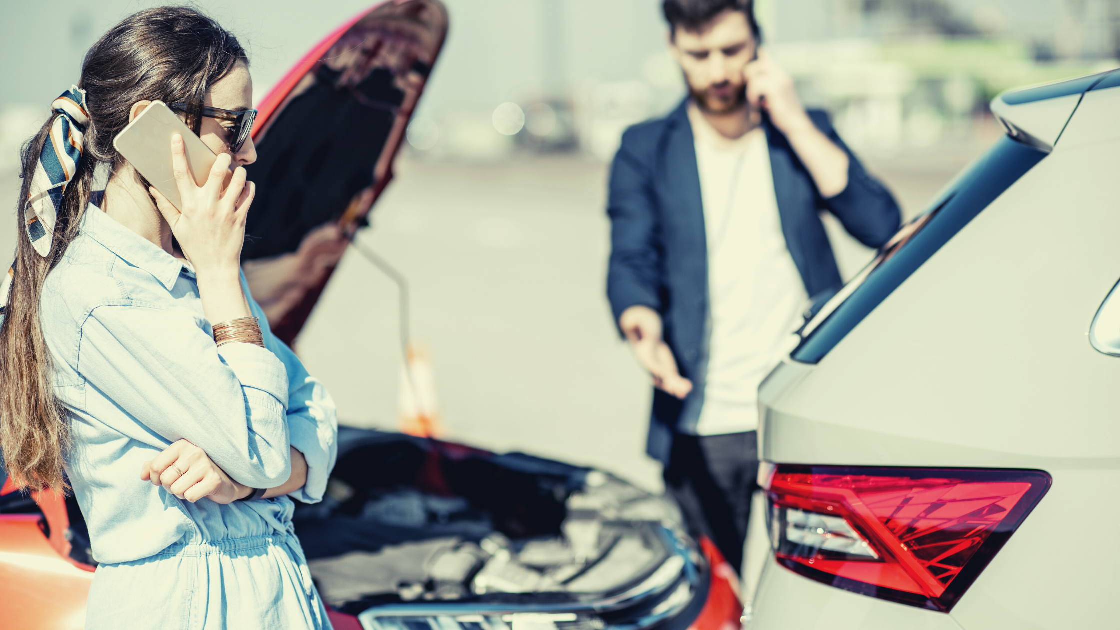 two people on the cell phones after an auto accident