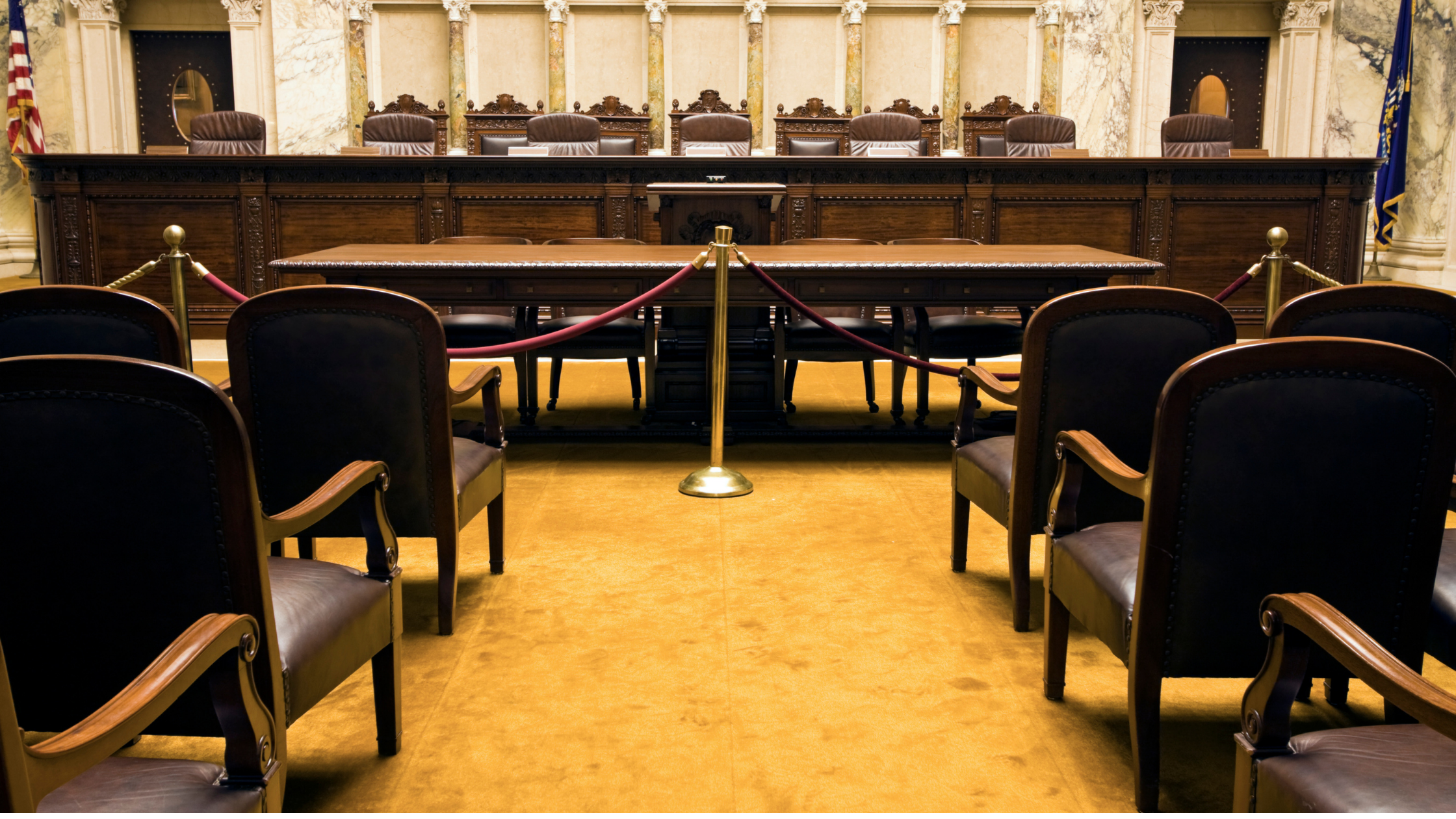 court room with flags