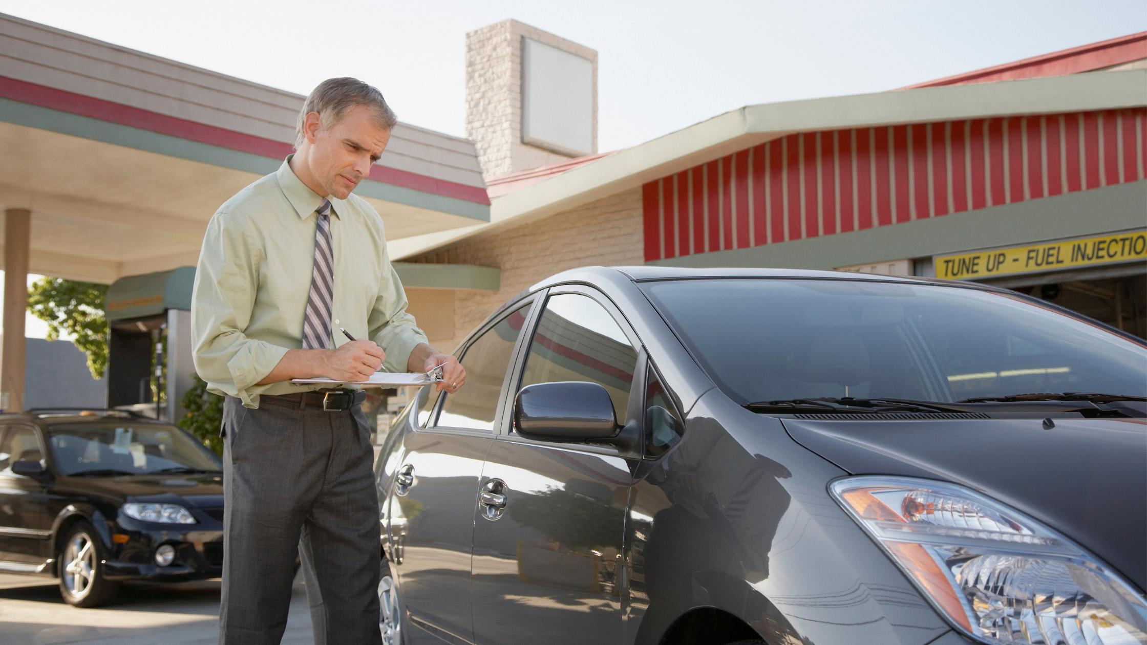 insurance adjuster observing a car