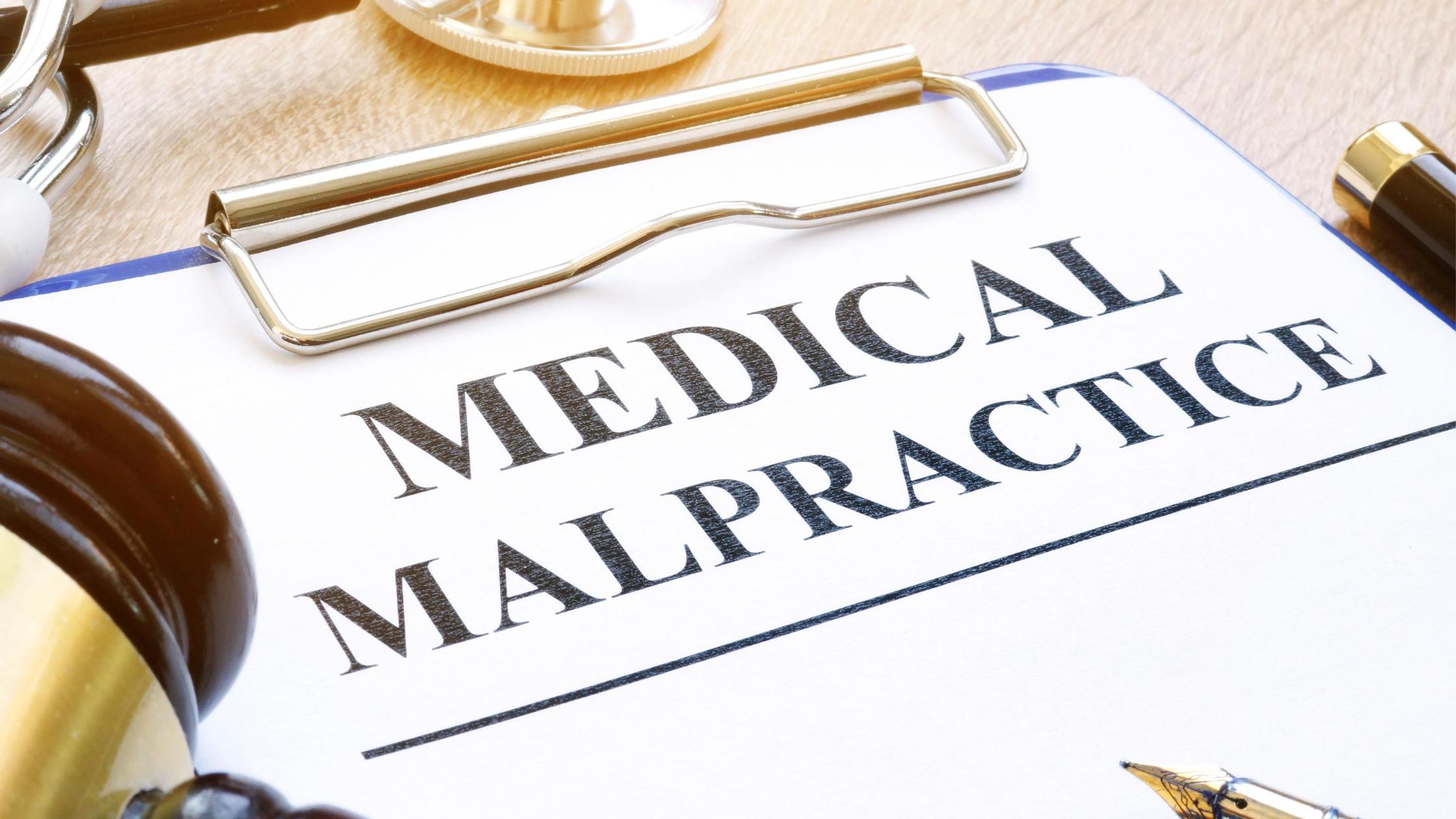 medical malpractice clipboard with gavel