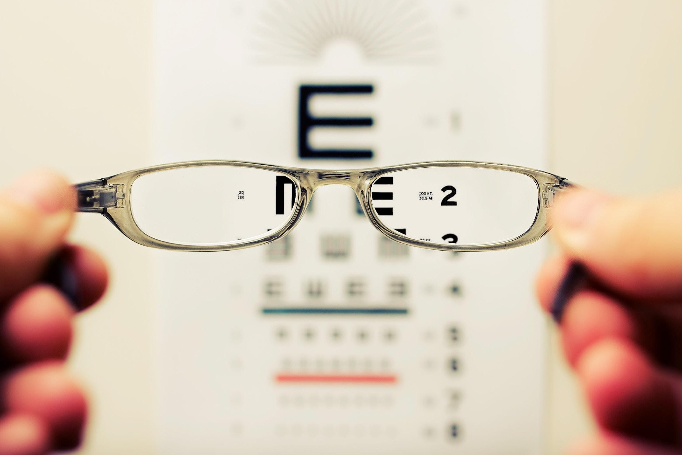 Glasses in front of vision chart