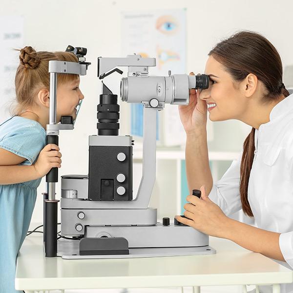 optometrist conducting an eye exam