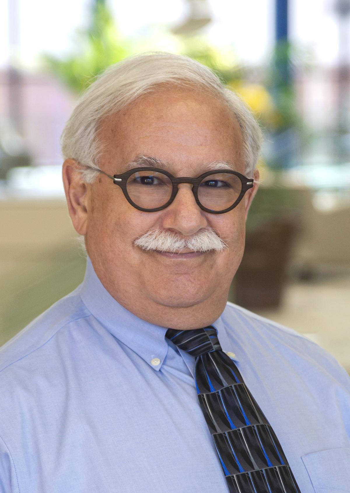 Dr. Paul A. Harris