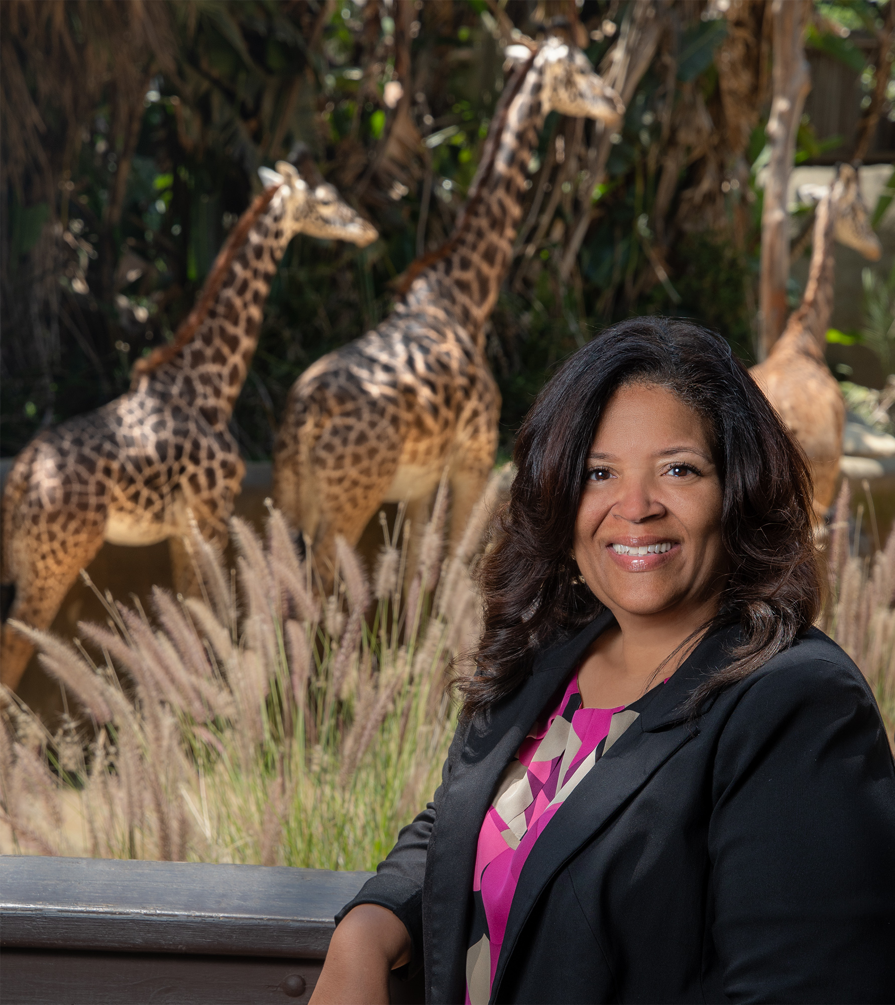 Denise Verret with a group of giraffe in the background