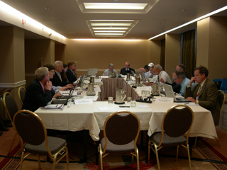 Image of business people working around large table