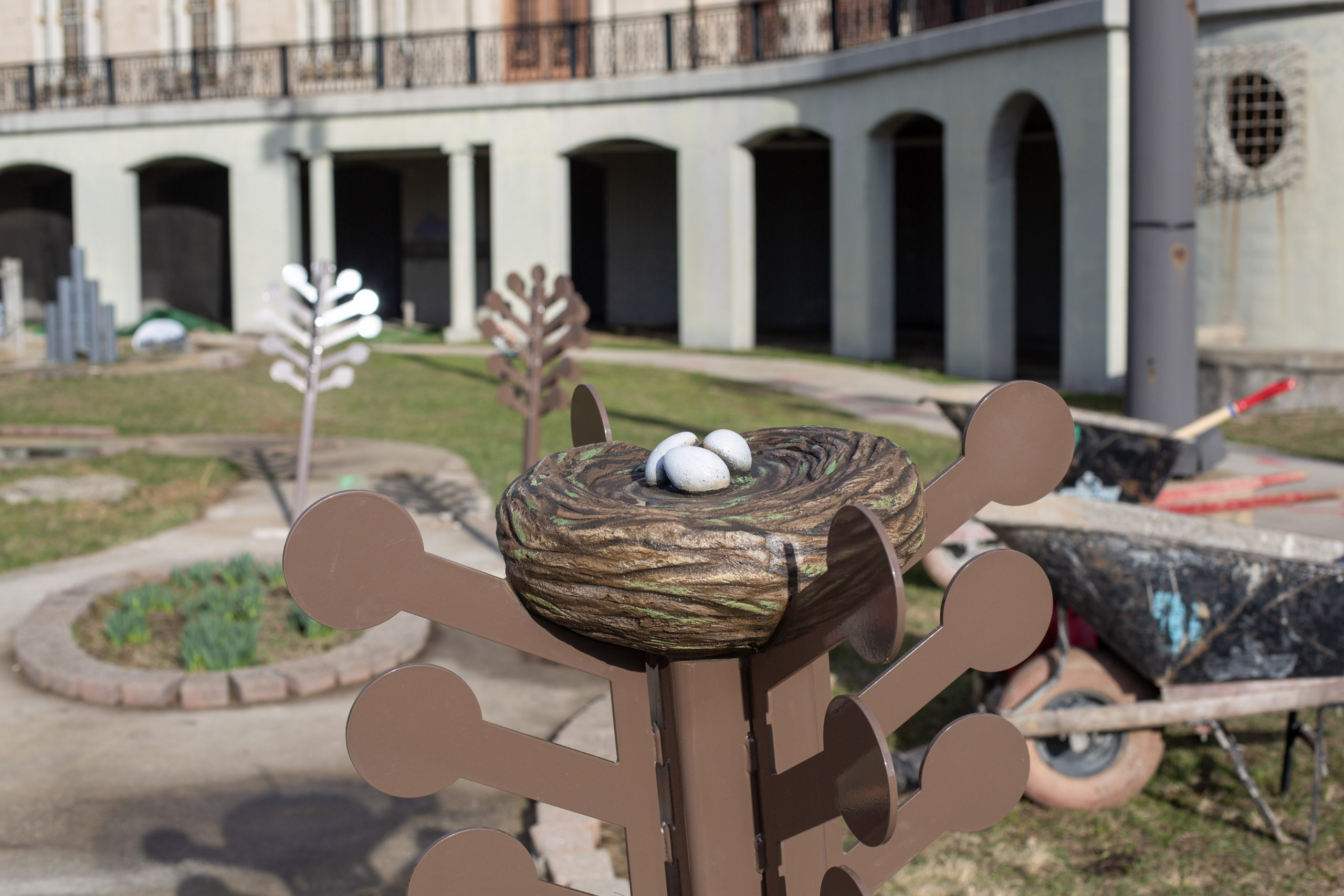 A bird's nest fixture is part of the conservation-themed golf course