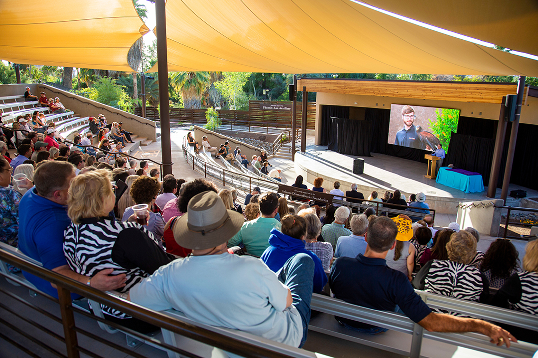 Photo of the Doornbos Discovery Amphitheater with guests watching a presentation