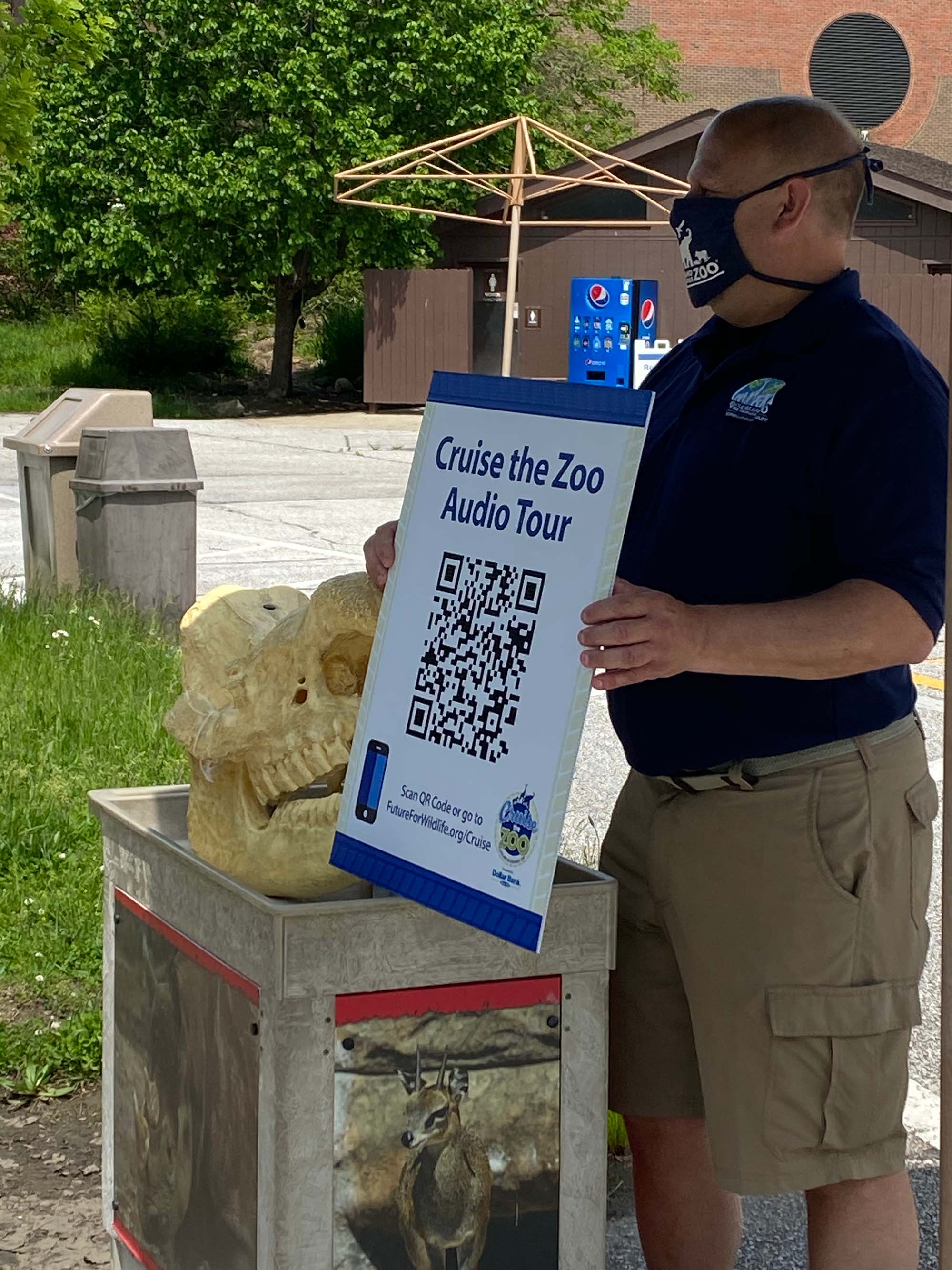 In lieu of personal interpreters Jim Nemet, Education Manager at Cleveland Metroparks Zoo, orients guests in cars to the Cruise the Zoo Audio Tour.