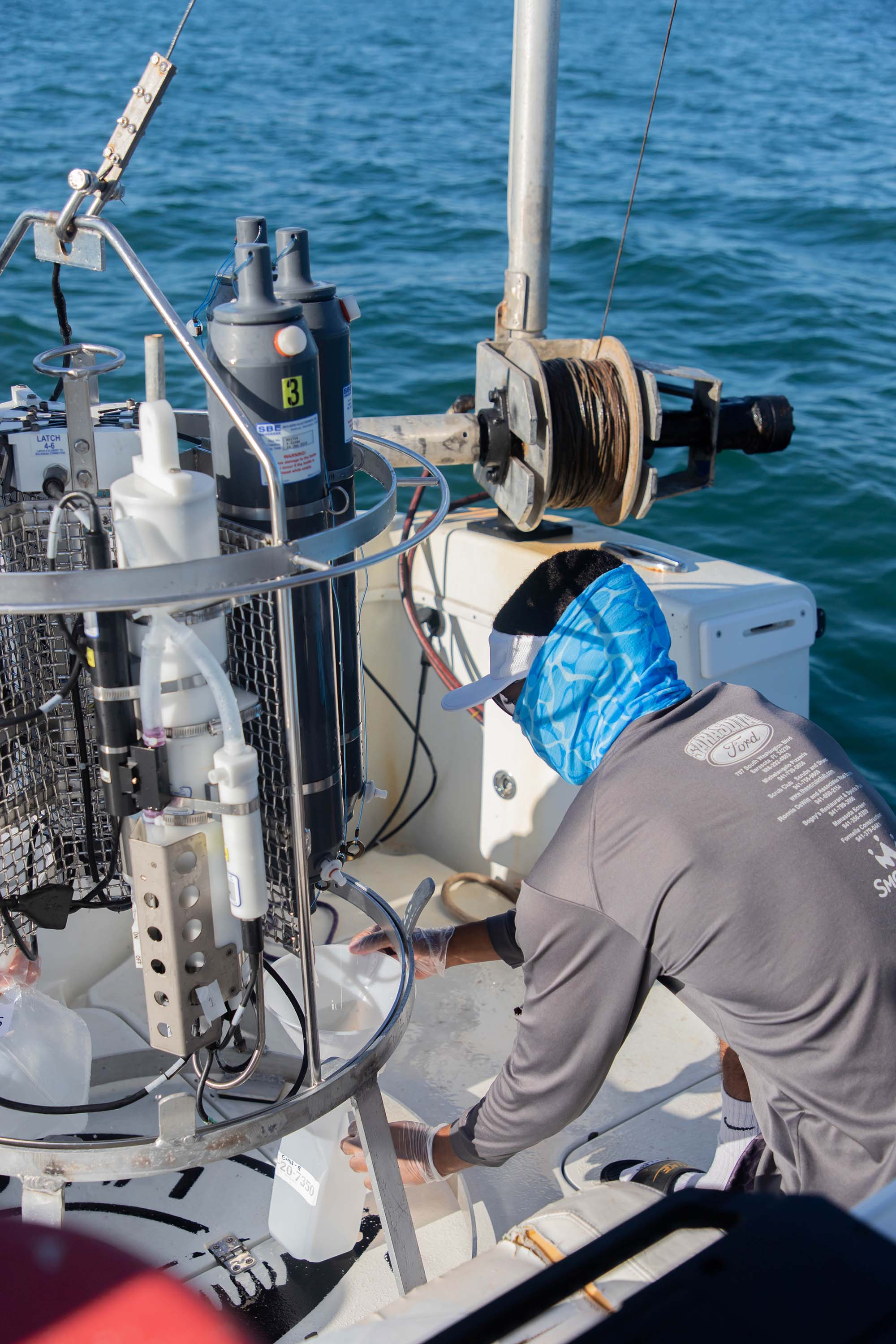 """Mote staff collected water samples and deployed a CTD (conductivity, temperature, depth) device at 14 stations between Sarasota and Tampa Bay (the """"Tampa Bay transect"""") to analyze the chemical, biological and physical properties at each location. The research goal is to better understand the parameters surrounding a red tide bloom, including initiation and termination. It is part of a five-year NOAA-funded study (of a total 28 stations in northern and southern transects), with surveys being performed monthly. Photos taken on Monday, August 10, 2020. Pictured: Jean Ozit, MarSci-LACE Intern. Photo Credit - Carlos Matthews/Mote Marine Laboratory"""