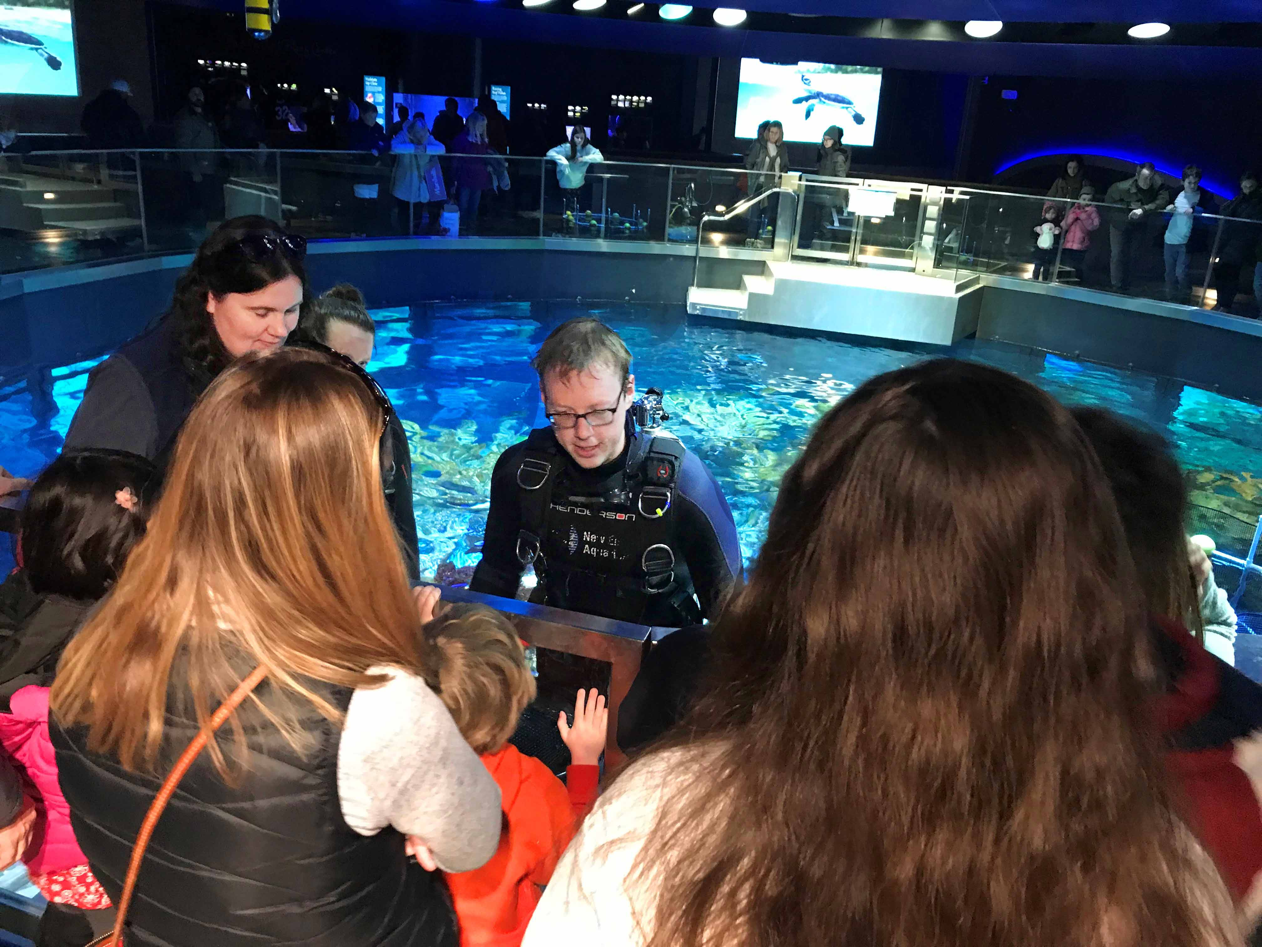 Mike O'Neill, supervisor of the Giant Ocean Tank at the New England Aquarium, talks to visitors during an on-site visitor advocacy campaign focusing on 30x30.