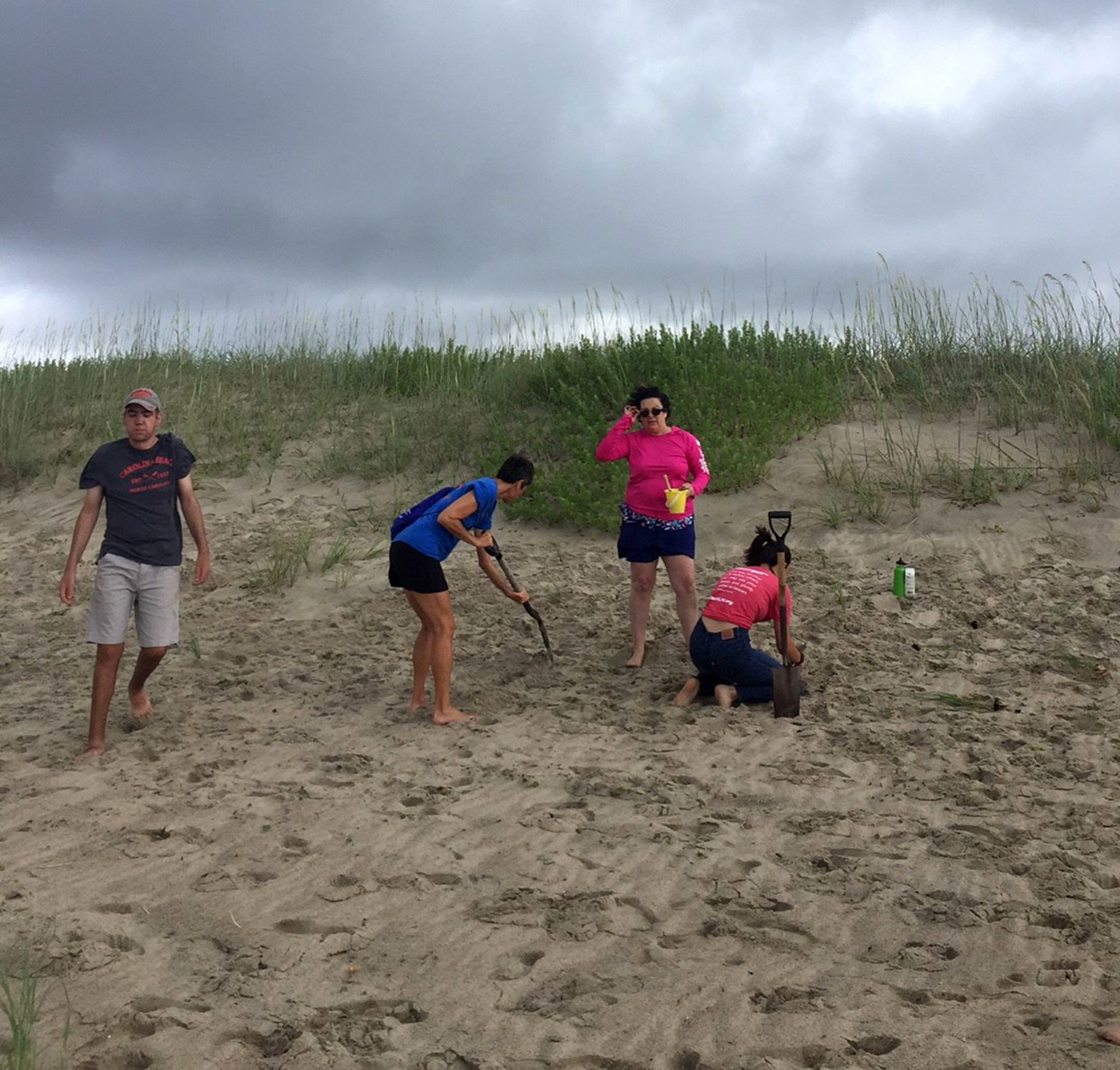 group of people cleaning up a beach