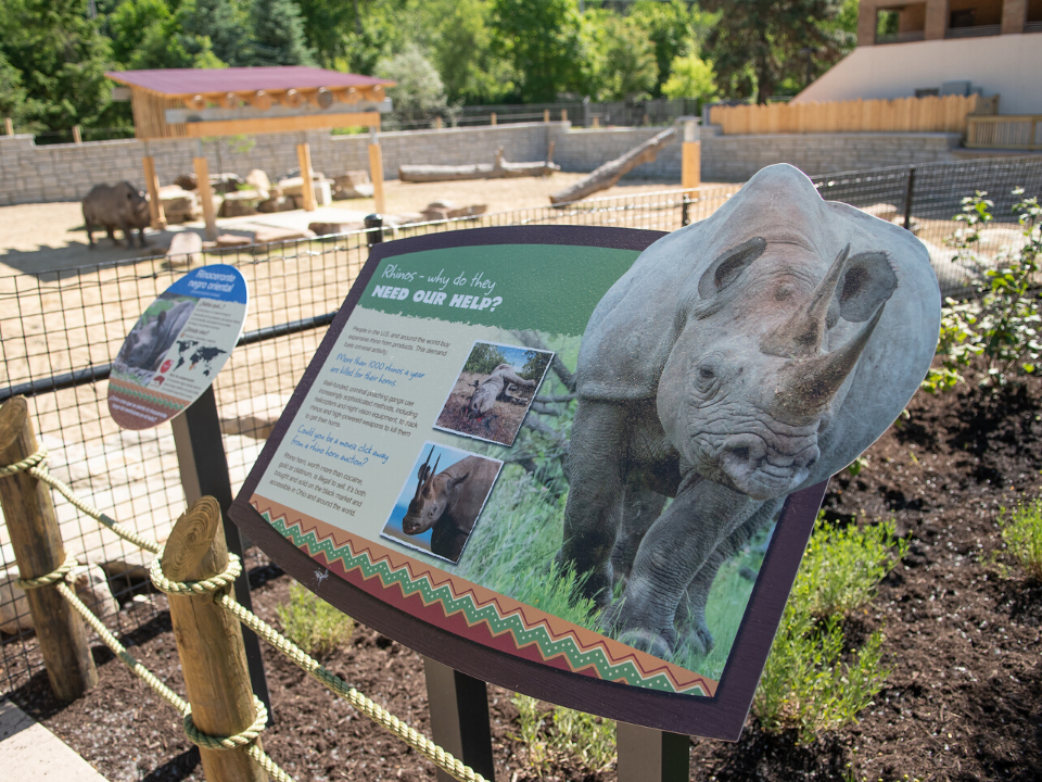 Educational sign at the new reserve with rhino in the background