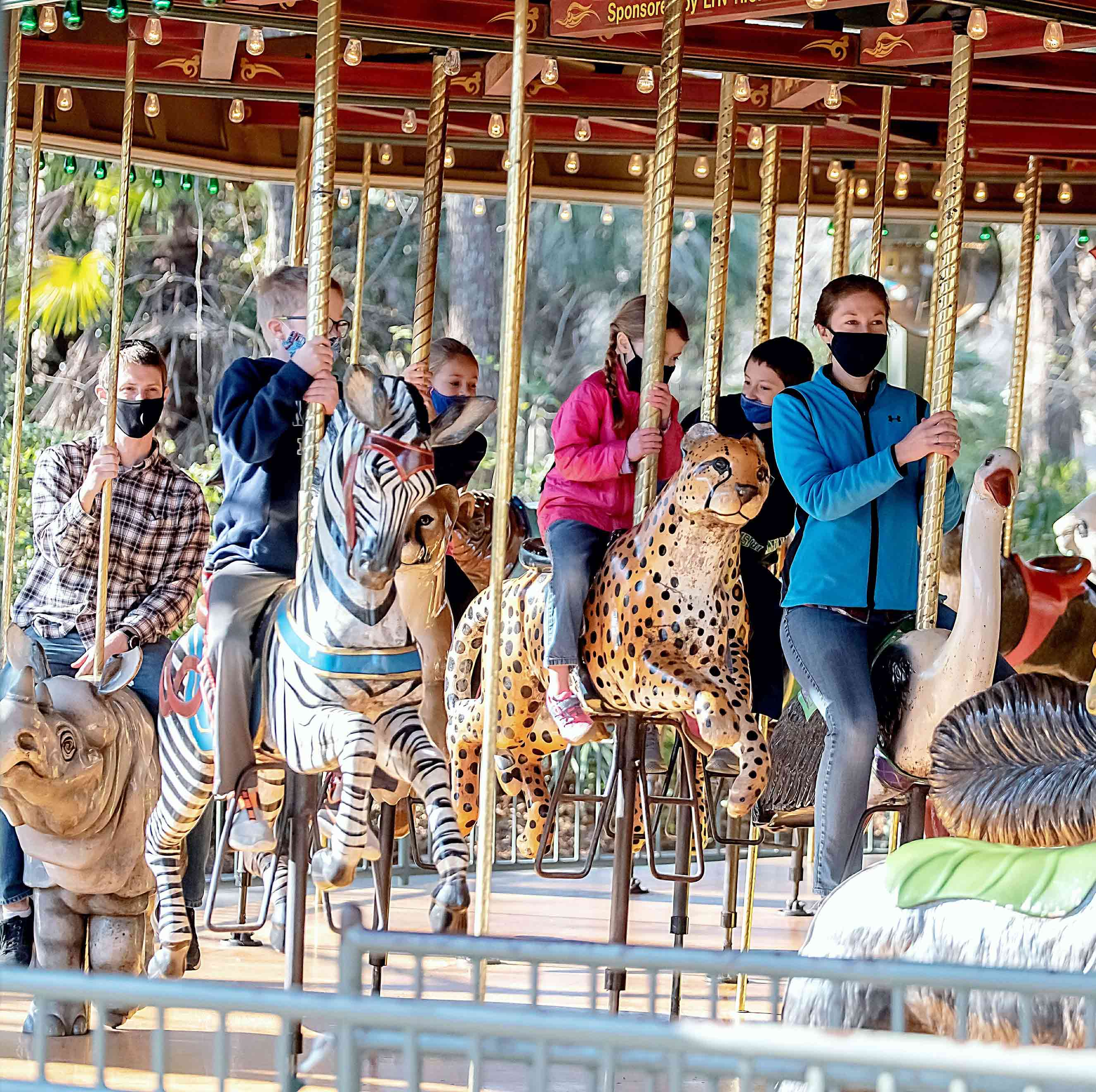 Guests riding the carousel at Riverbanks Zoo and Garden