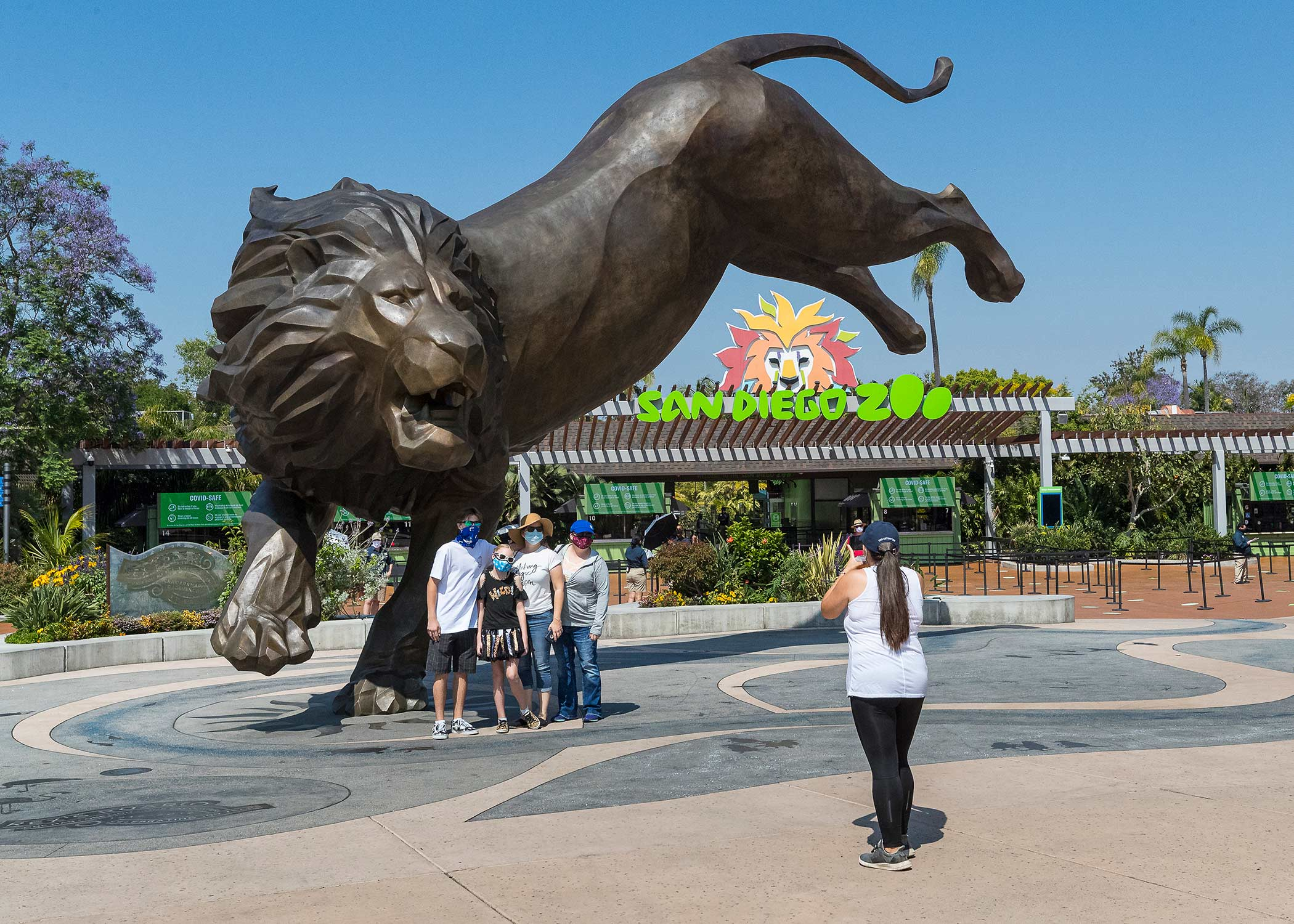 Guests taking a photo outside of San Diego Zoos' gate