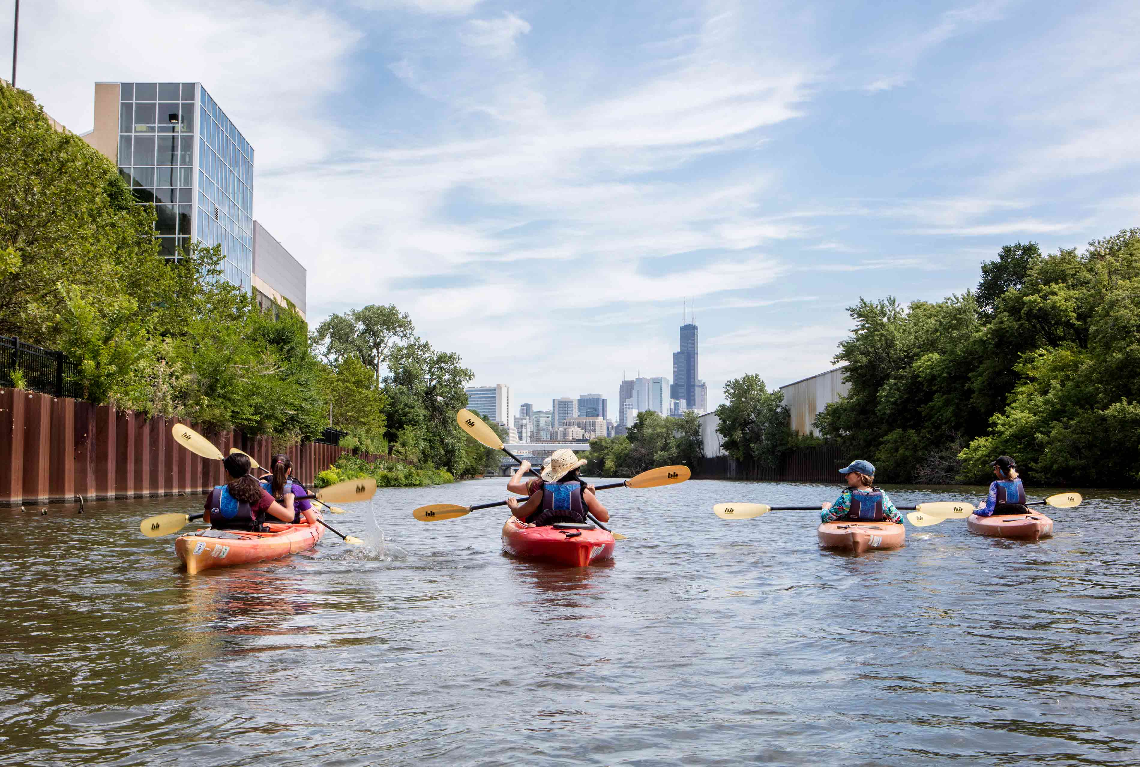 Participants of Shedd Aquarium's Kayak for Conservation program paddle south on the Chicago River toward new habitats that float on the river's surface, which were installed by Shedd and their partners as part of an ongoing habitat restoration project. During the mission-driven, revenue-generation kayaking experience, participants learn about the river and how to take conservation actions that improve its health.