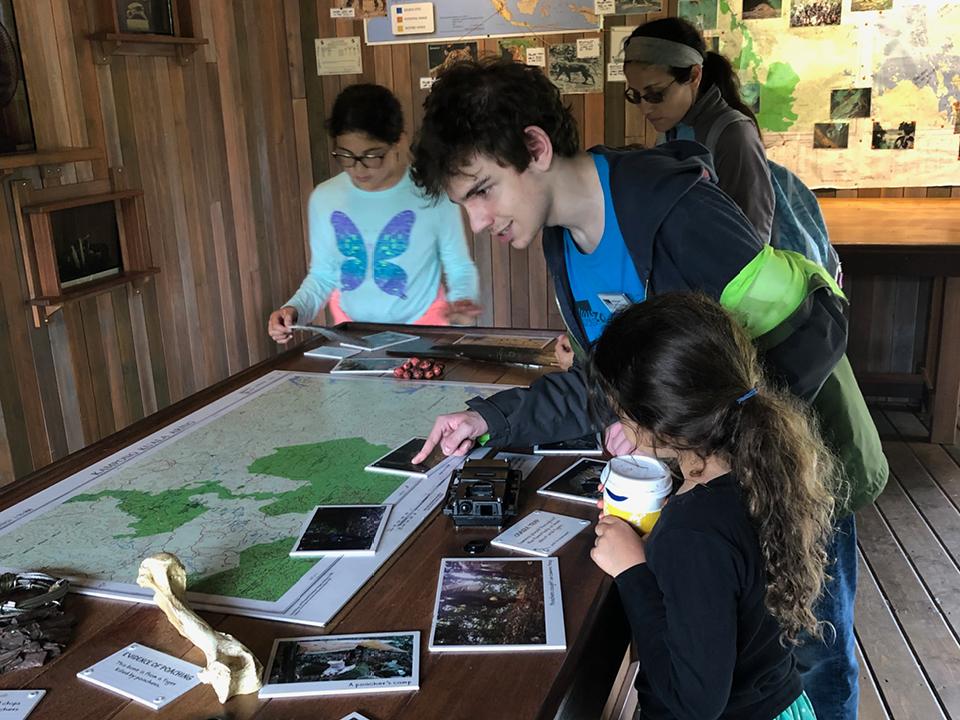 Woodland Park Zoo volunteer Joaquin assists guests