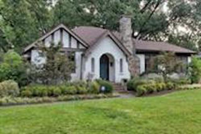white house with cozy garden