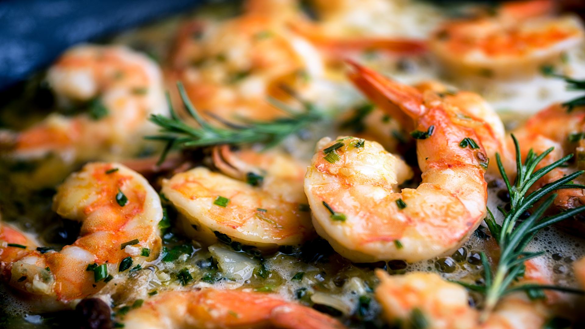 Shrimp sauteing in butter flavored oil.