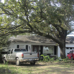 house with car in front