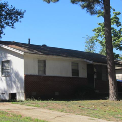 Brown house with tree
