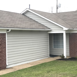brick house with white garage