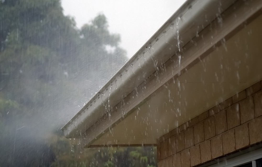 Rain Falling on House with Gutters