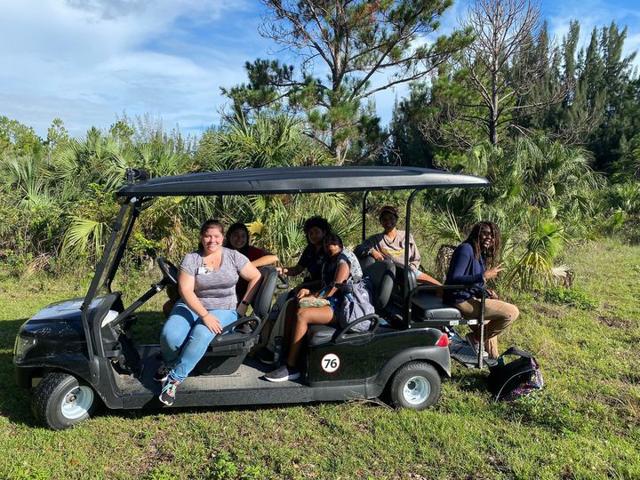 Undergraduates examining an invasive boa constrictor at Zoo Miami's hospital