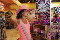 guest trying on hat at Zoo Miami gift shop