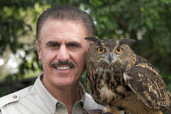 Ron Magill holding a great horned owl