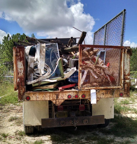 A loaded dump truck after removing dirt and debris from inside the bunker