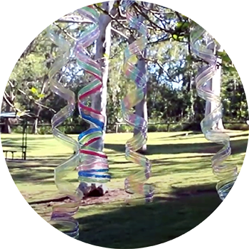 Photo of wind spinners made out of recycled plastic bottles.