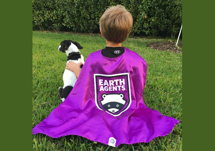 Little boy with dog wearing an Earth Agents cape