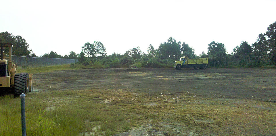 truck clearing fill and invasive plants at first restoration site