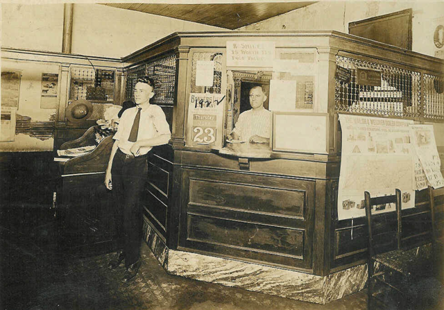 vintage photo of bank teller