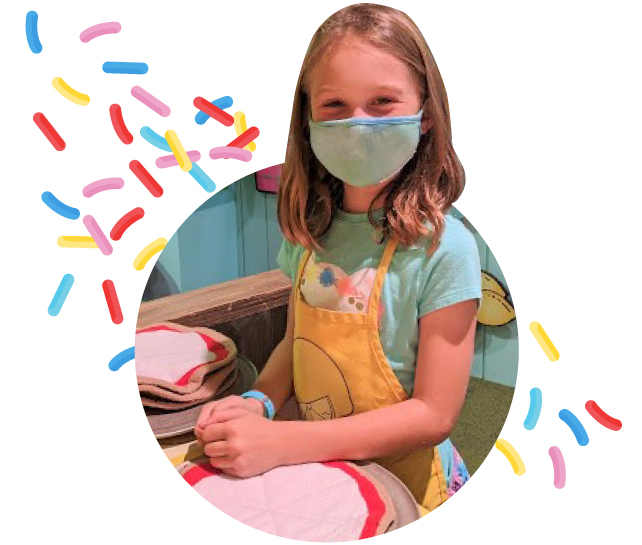 Girl in mask making Pizza at Marbles