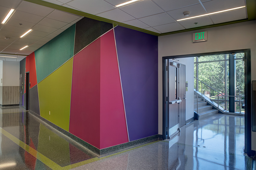 Dean's wall with acoustical design elements