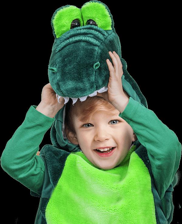 Kid in a dinosaur costume