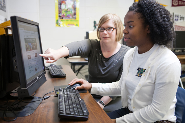 Staff Member Guiding a Student through an Online FAFSA Completion