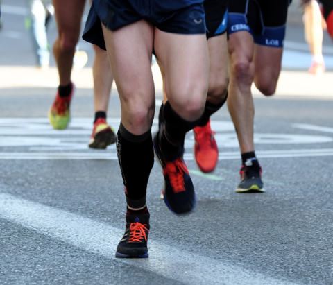 A group of runners race in a 5k in Tulsa, Oklahoma.