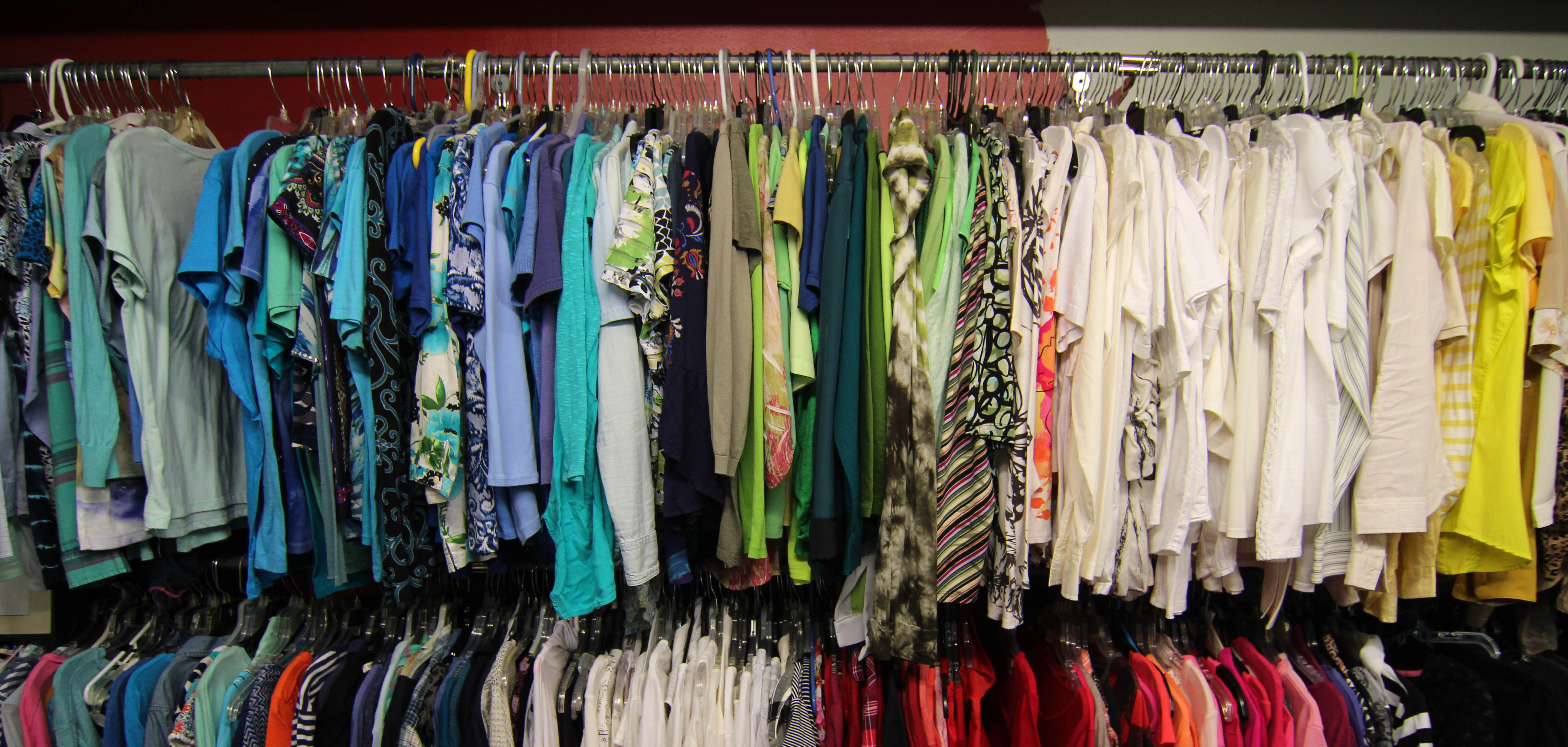 A rack of colorful clothes at Animal Aid in Tulsa, Oklahoma.
