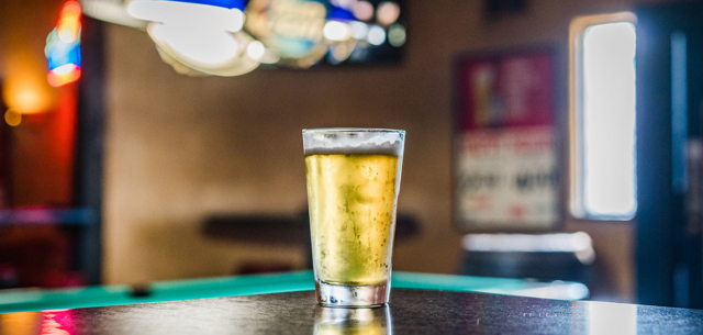 A beer sits on a pool table at a bar in Tulsa, Oklahoma.