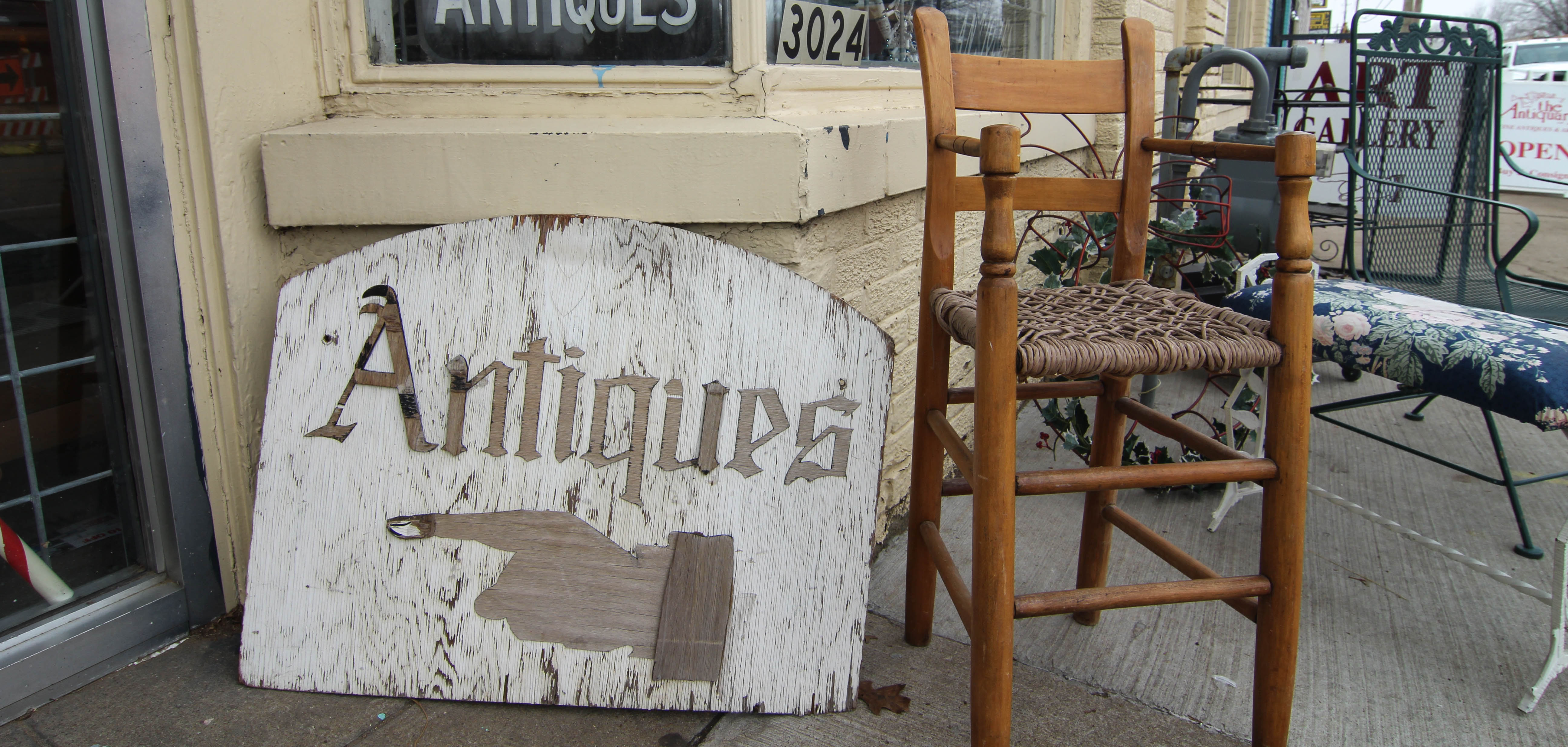 An antique sign outside of The Antiquary in Tulsa, Oklahoma.