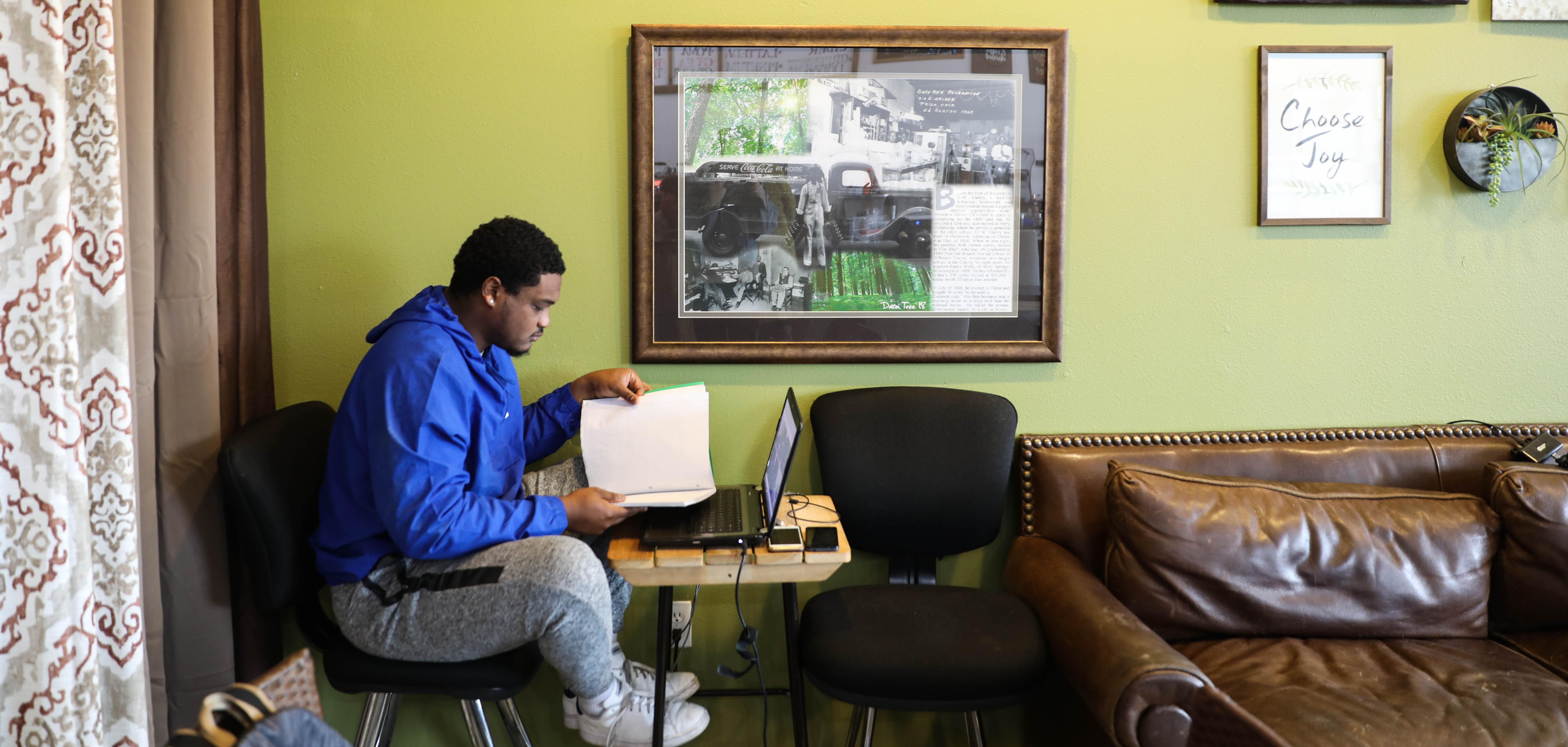 A man studies at Black Wall Street Liquid Lounge in Tulsa's Greenwood District.