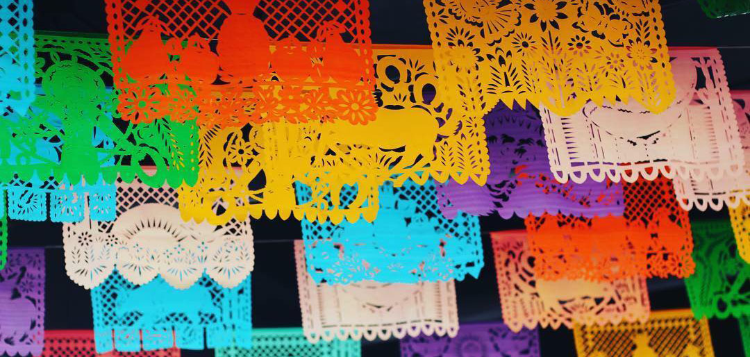 Vibrant, brightly colored banners hang in the interior of Calaveras Mexican Grill, located in the Kendall-Whittier neighborhood east of downtown Tulsa, Oklahoma.