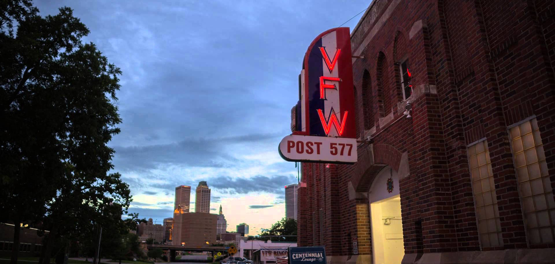 The neon sign at the VFW's Centennial Lounge overlooks downtown Tulsa, Oklahoma.