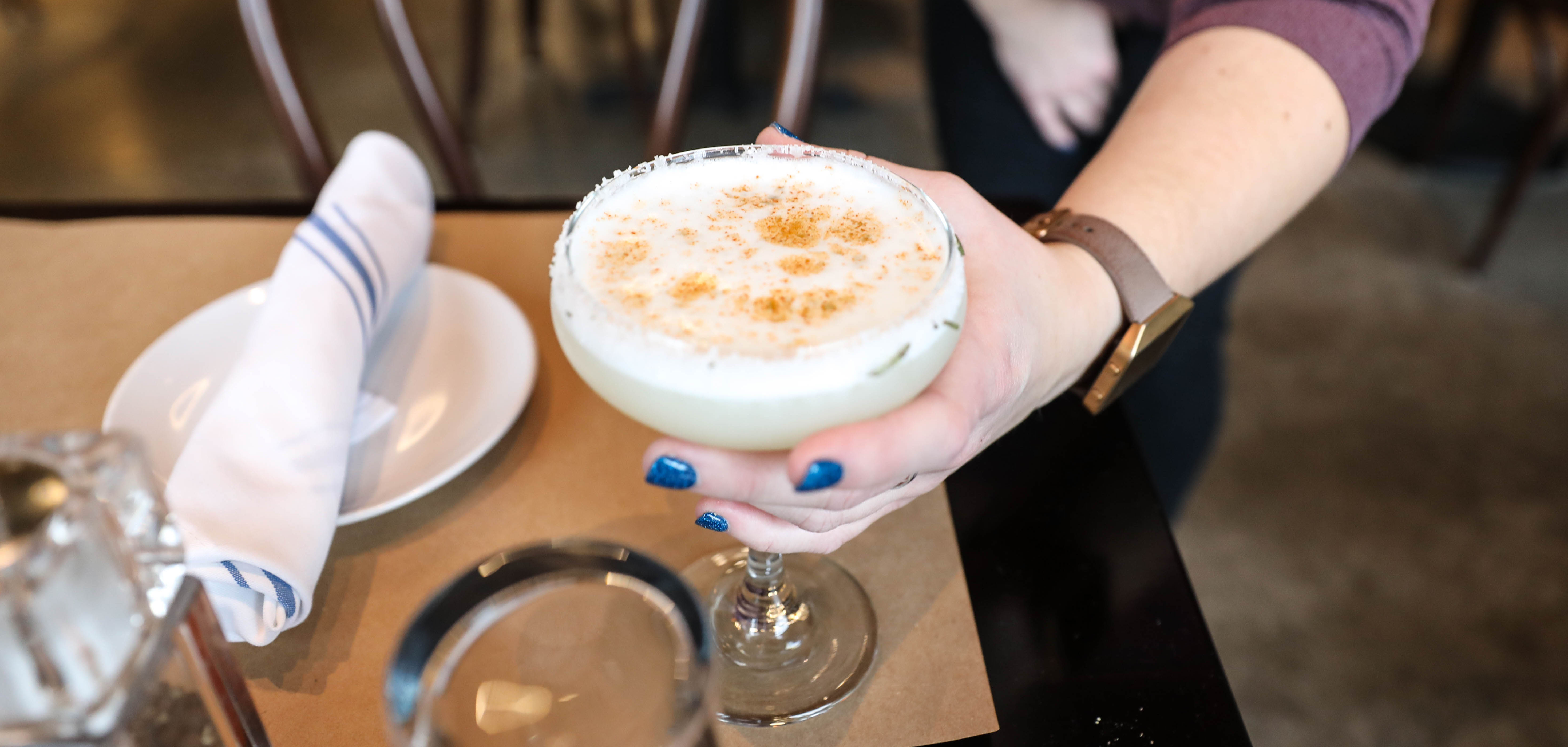 A woman holds a cocktail at Duet in the Tulsa Arts District.