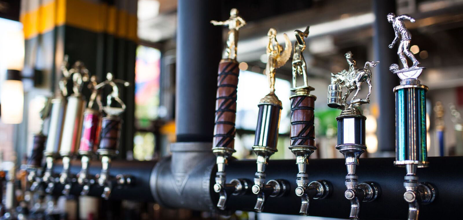 Taps in the center of the bar at Elgin Park in downtown Tulsa, Oklahoma.