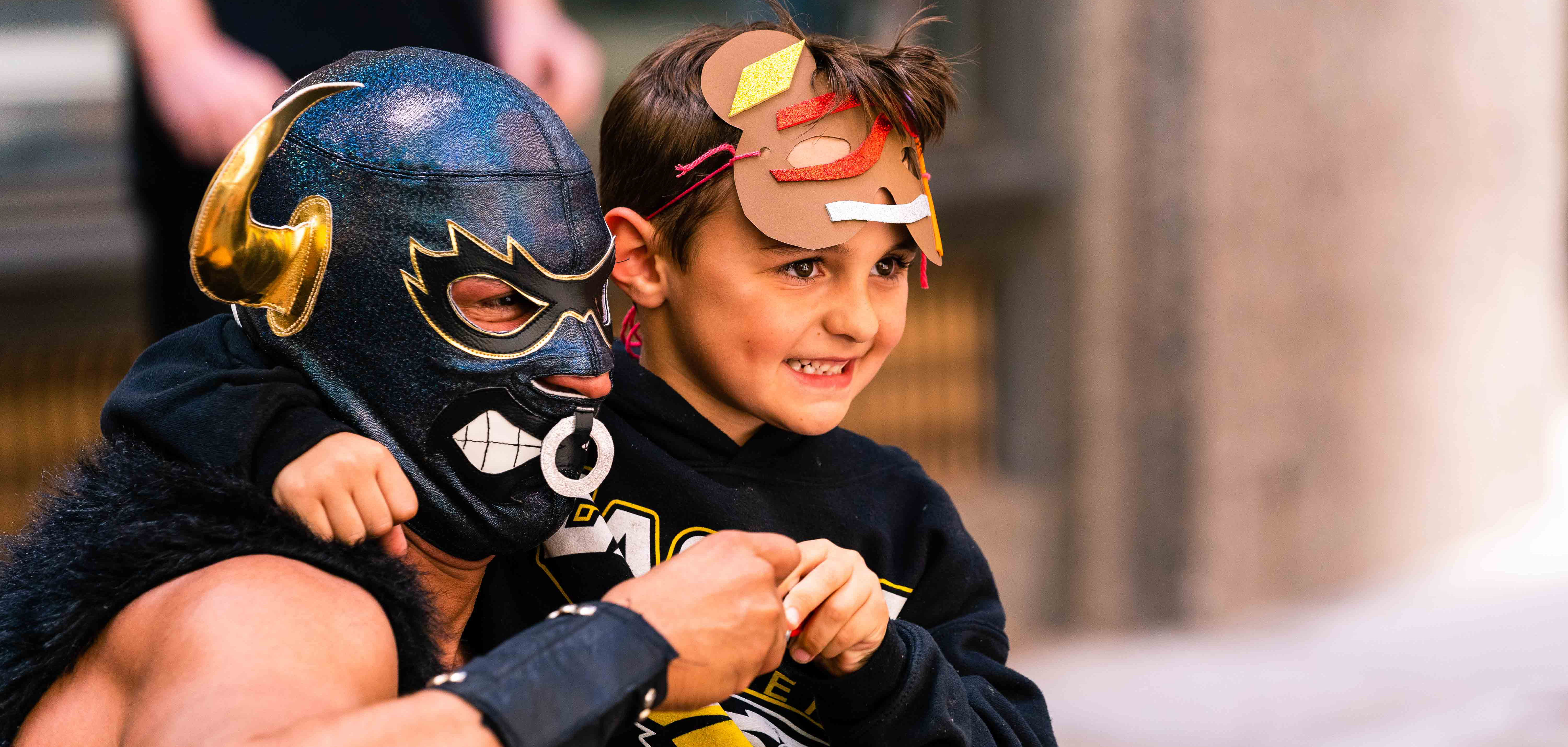 A luchador and kid at Elote's Cinco de Mayo event in downtown Tulsa, Oklahoma's Deco District.