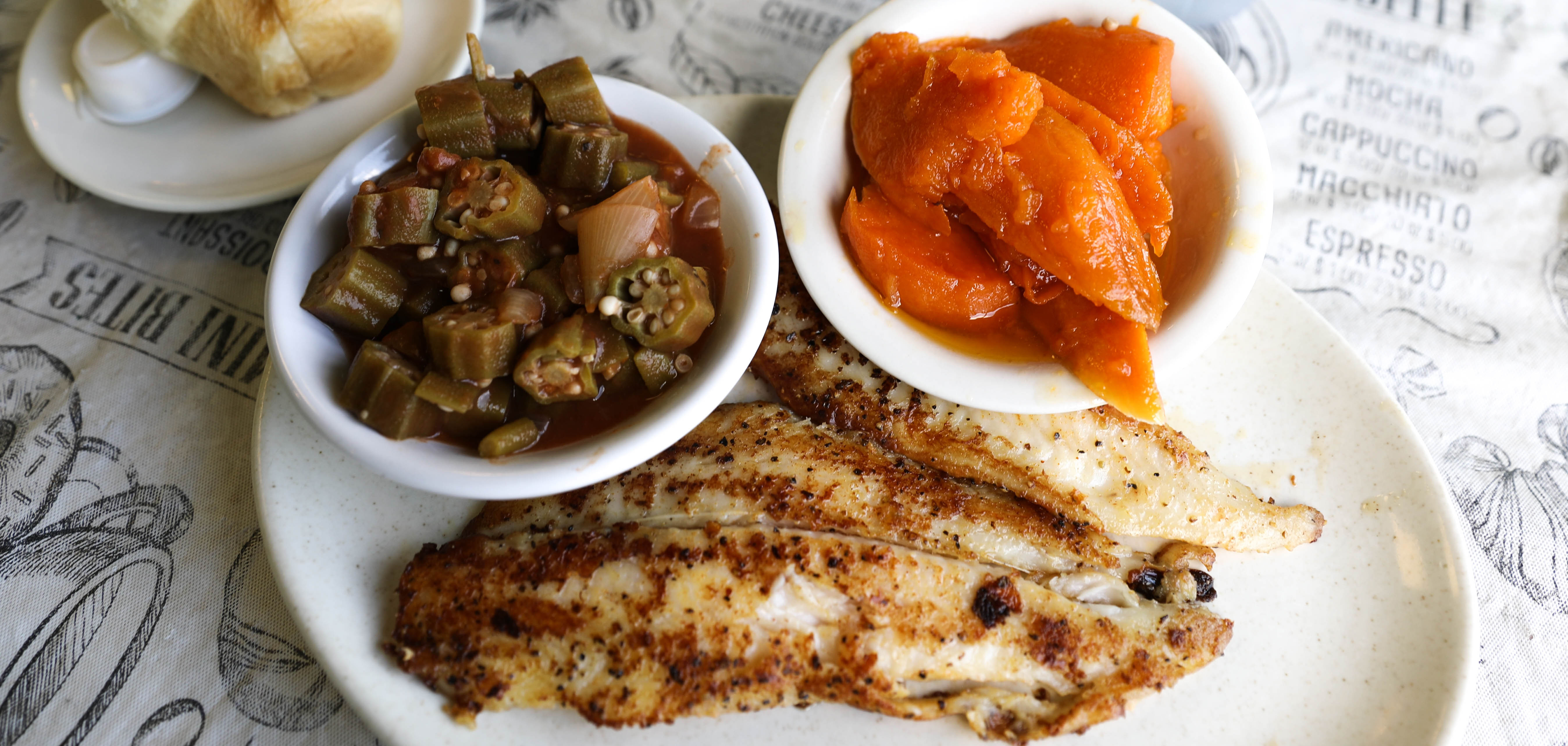 Grilled catfish with candied yams and okra and tomatoes at Evelyn's in North Tulsa.